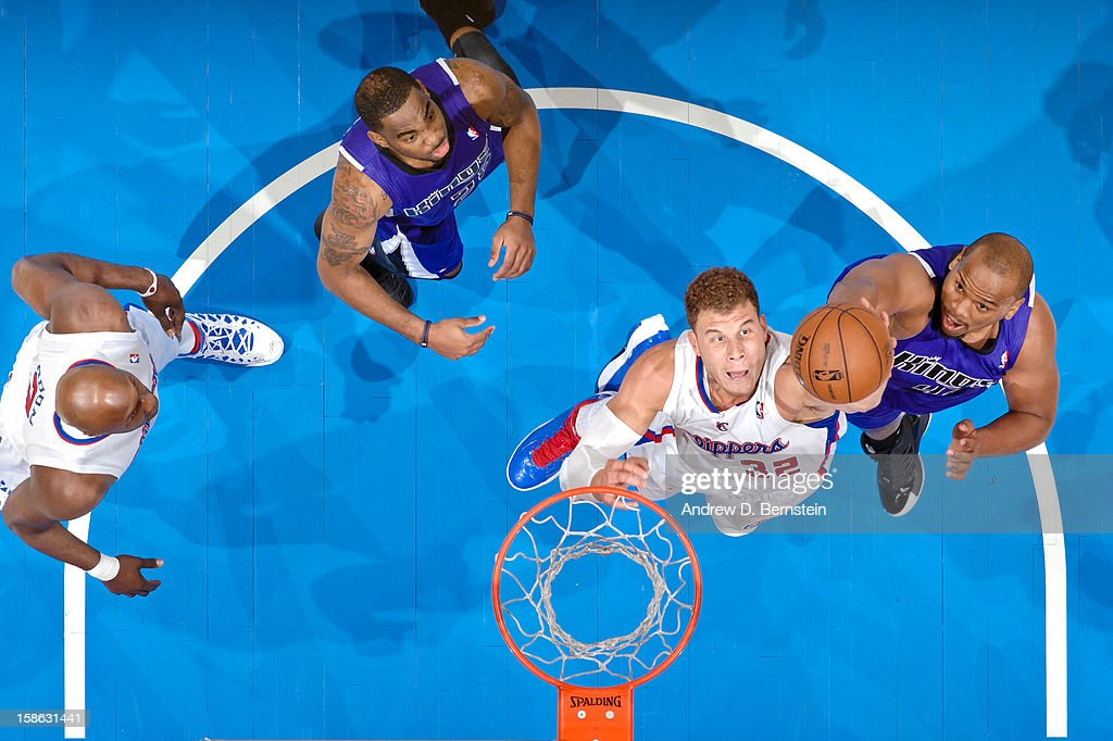 Blake Griffin #32 of the Los Angeles Clippers grabs a rebound against Chuck Hayes #42 of the Sacramento Kings at Staples Center on December 21, 2012 in Los Angeles, California.