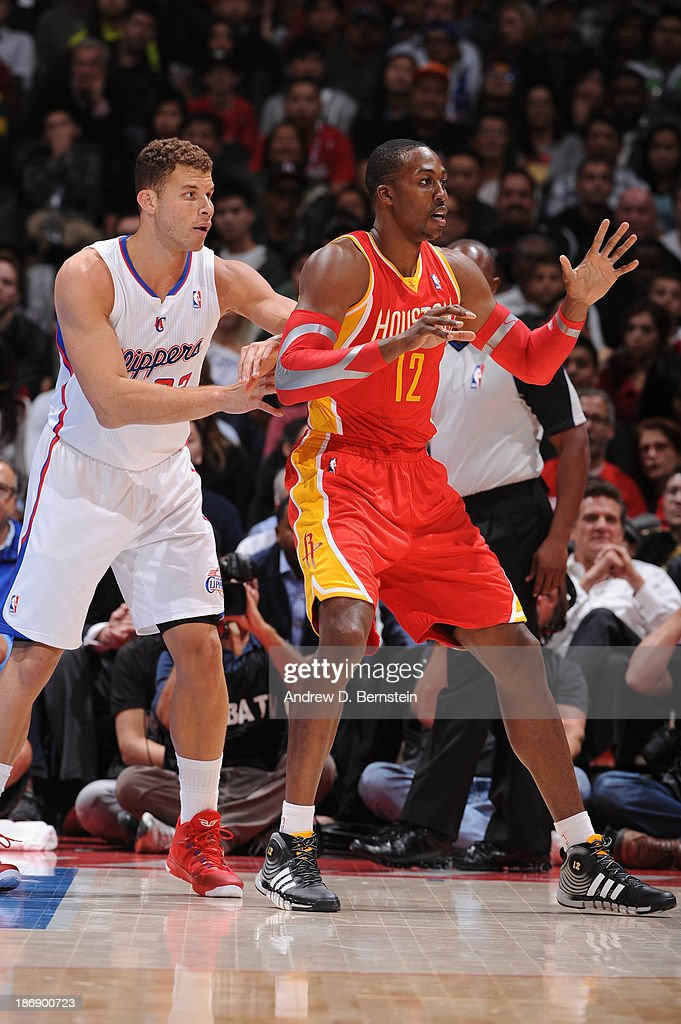 Blake Griffin #32 of the Los Angeles Clippers guards Dwight Howard #12 of the Houston Rockets at Staples Center on November 4, 2013 in Los Angeles, California.
