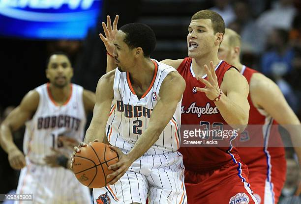 Blake Griffin of the Los Angeles Clippers guards Shaun Livingston of the Charlotte Bobcats during their game at Time Warner Cable Arena on March 7...