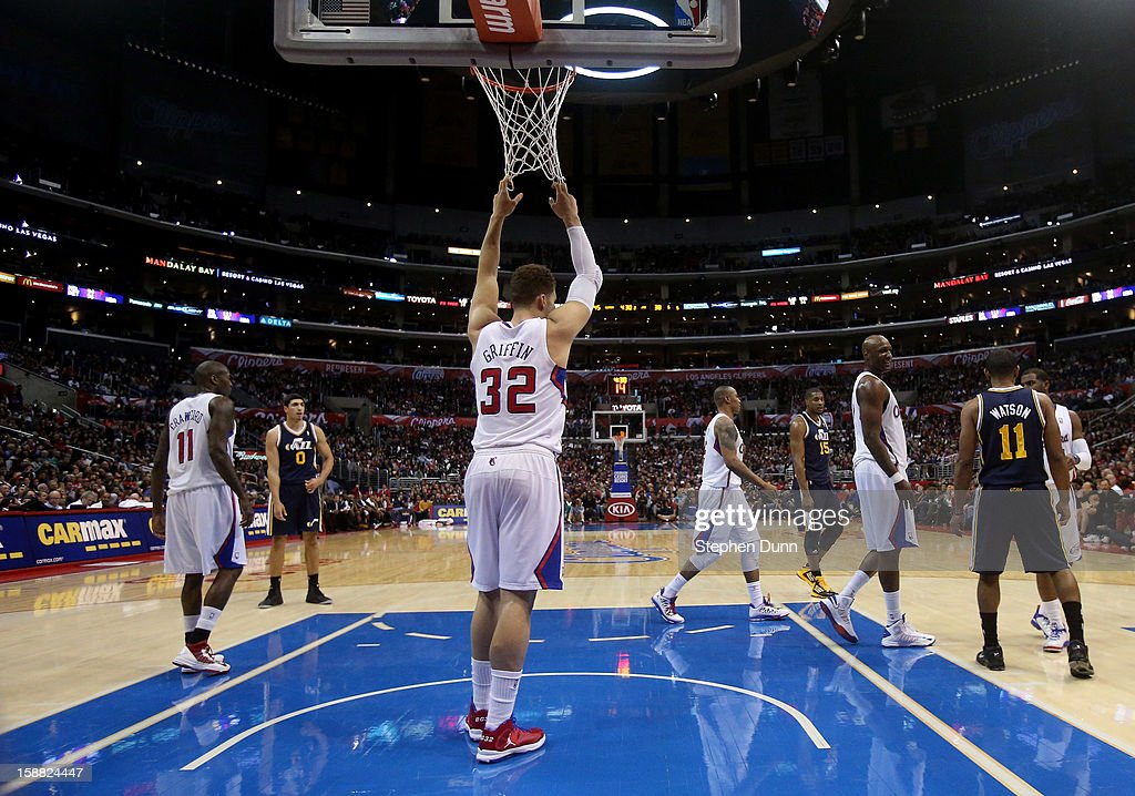 Blake Griffin #32 of the Los Angeles Clippers hangs on the net as he rests during a stoppage in play against the Utah Jazz at Staples Center on December 30, 2012 in Los Angeles, California. The Clippers won 107-96.