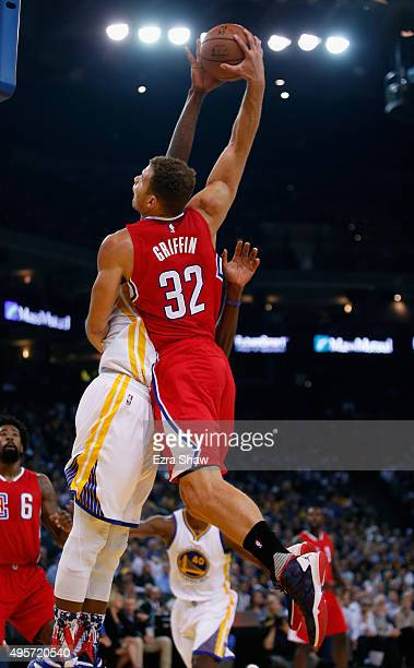 Blake Griffin of the Los Angeles Clippers has a shot blocked by Festus Ezeli of the Golden State Warriors at ORACLE Arena on November 4 2015 in...