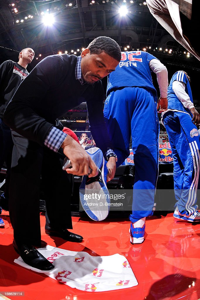 Blake Griffin #32 of the Los Angeles Clippers has Mission Court Grip applied to his sneakers before playing against the Sacramento Kings at Staples Center on December 21, 2012 in Los Angeles, California.