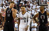 Blake Griffin of the Los Angeles Clippers has some words with Damian Lillard of the Portland Trail Blazers as Chris Paul of the Los Angeles Clippers...