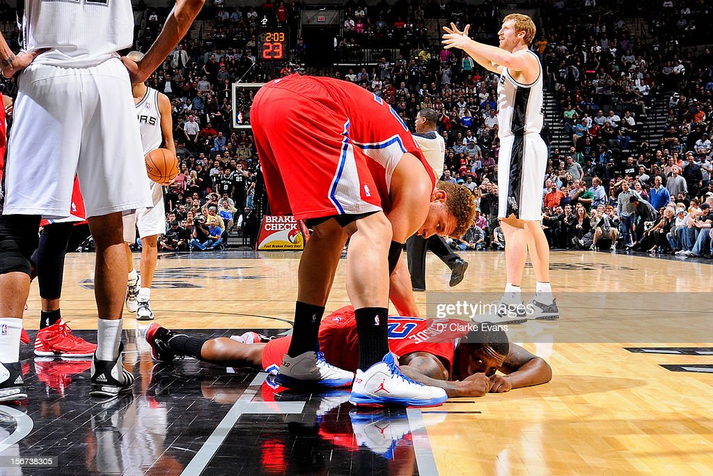 Blake Griffin #32 of the Los Angeles Clippers helps up teammate Eric Bledsoe #12 against the San Antonio Spurs on November 19, 2012 at the AT&T Center in San Antonio, Texas.