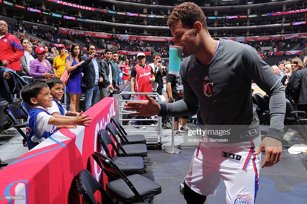 <a gi-track='captionPersonalityLinkClicked' href=/galleries/search?phrase=Blake+Griffin+-+Basketball+Player&family=editorial&specificpeople=4216010 ng-click='$event.stopPropagation()'>Blake Griffin</a> #32 of the Los Angeles Clippers high-fives fans as he exits the court after a game against the Portland Trail Blazers at Staples Center on April 16, 2013 in Los Angeles, California.