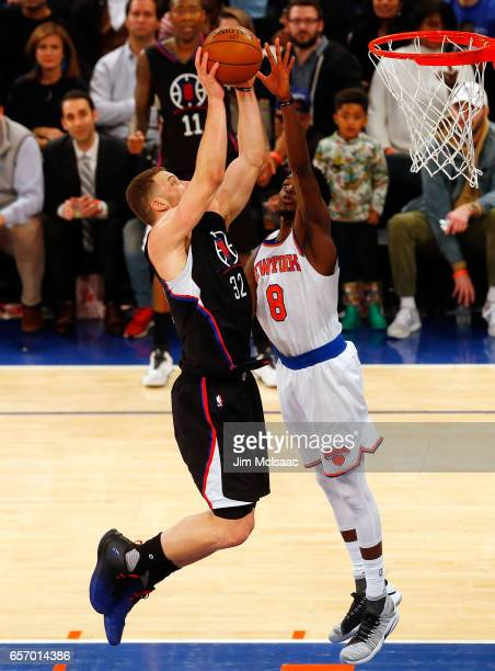 Blake Griffin of the Los Angeles Clippers in action against Justin Holiday of the New York Knicks at Madison Square Garden on February 8 2017 in New...
