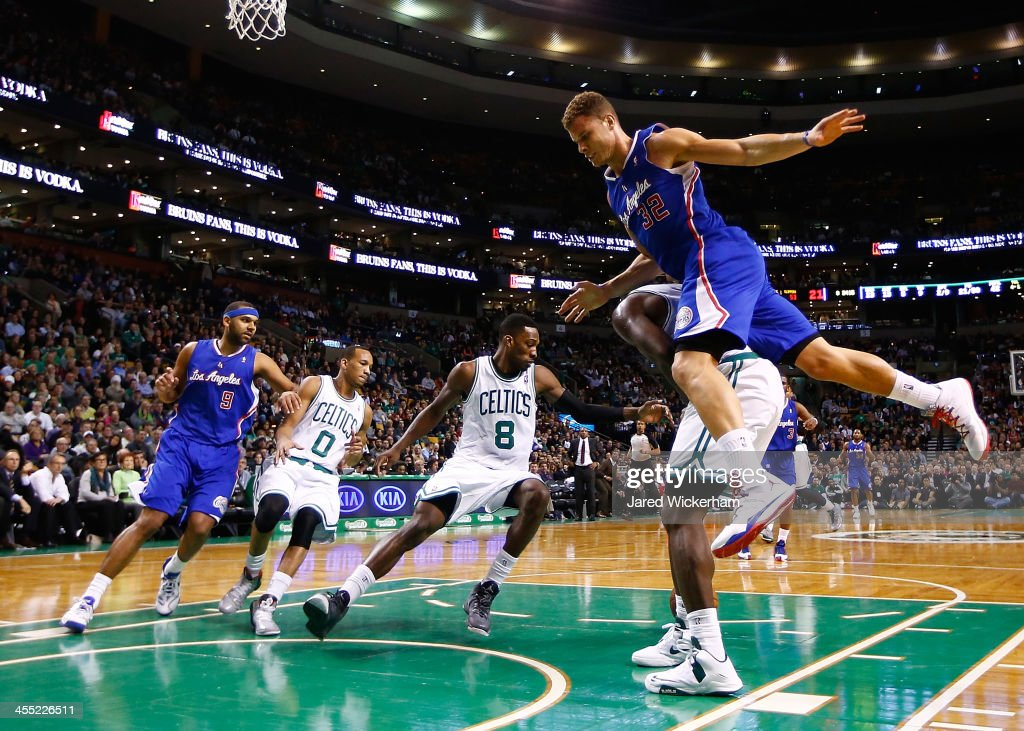 Blake Griffin #32 of the Los Angeles Clippers jumps on the back of Brandon Bass #30 of the Boston Celtics in the second half during the game at TD Garden on December 11, 2013 in Boston, Massachusetts.