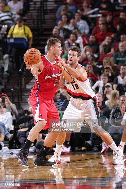 Blake Griffin of the Los Angeles Clippers looks to pass against Victor Claver of the Portland Trail blazers on October 7 2013 at the Moda Center...