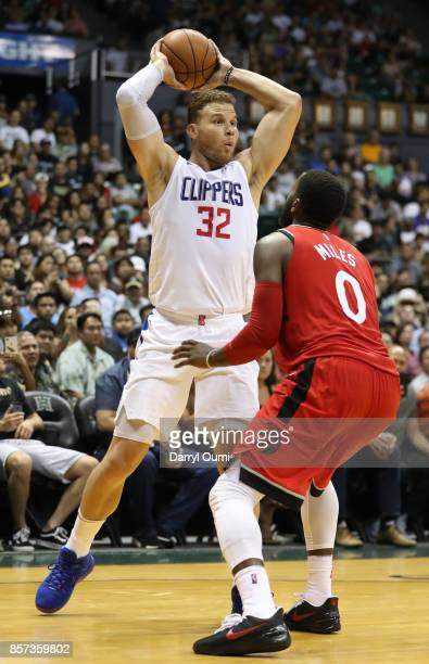 Blake Griffin of the Los Angeles Clippers looks to pass over CJ Miles of the Toronto Raptors during the third quarter at the Stan Sheriff Center on...