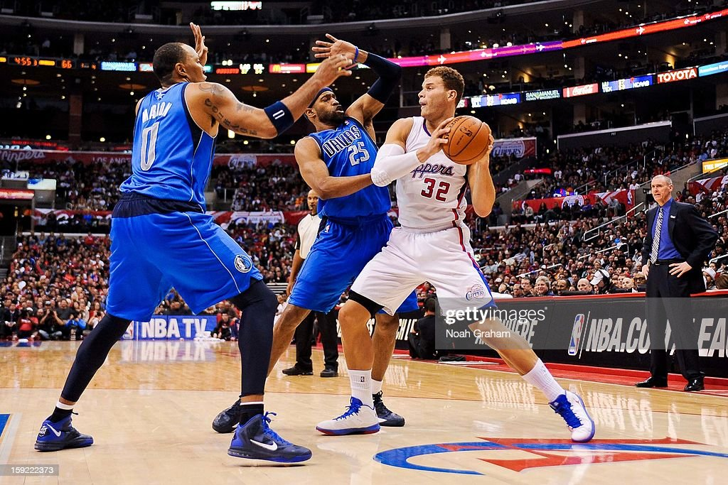 <a gi-track='captionPersonalityLinkClicked' href=/galleries/search?phrase=Blake+Griffin+-+Basketball+Player&family=editorial&specificpeople=4216010 ng-click='$event.stopPropagation()'>Blake Griffin</a> #32 of the Los Angeles Clippers looks to pass the ball against <a gi-track='captionPersonalityLinkClicked' href=/galleries/search?phrase=Shawn+Marion&family=editorial&specificpeople=201566 ng-click='$event.stopPropagation()'>Shawn Marion</a> #0 and <a gi-track='captionPersonalityLinkClicked' href=/galleries/search?phrase=Vince+Carter&family=editorial&specificpeople=201488 ng-click='$event.stopPropagation()'>Vince Carter</a> #25 of the Dallas Mavericks at Staples Center on January 9, 2013 in Los Angeles, California.