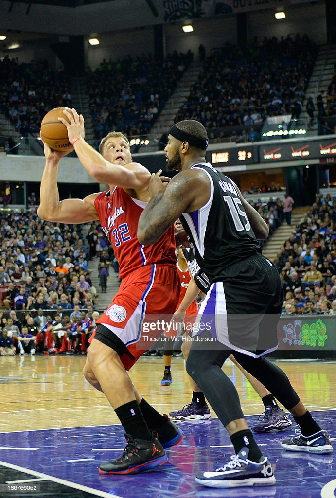 Blake Griffin #32 of the Los Angeles Clippers looks to shoot over DeMarcus Cousins #15 of the Sacramento Kings during the third quarter at Sleep Train Arena on November 1, 2013 in Sacramento, California.