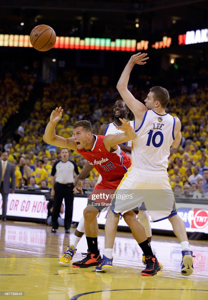 Blake Griffin #32 of the Los Angeles Clippers loses control of the ball while covered by David Lee #10 and Draymond Green #23 of the Golden State Warriors in Game Six of the Western Conference Quarterfinals during the 2014 NBA Playoffs at ORACLE Arena on May 1, 2014 in Oakland, California.