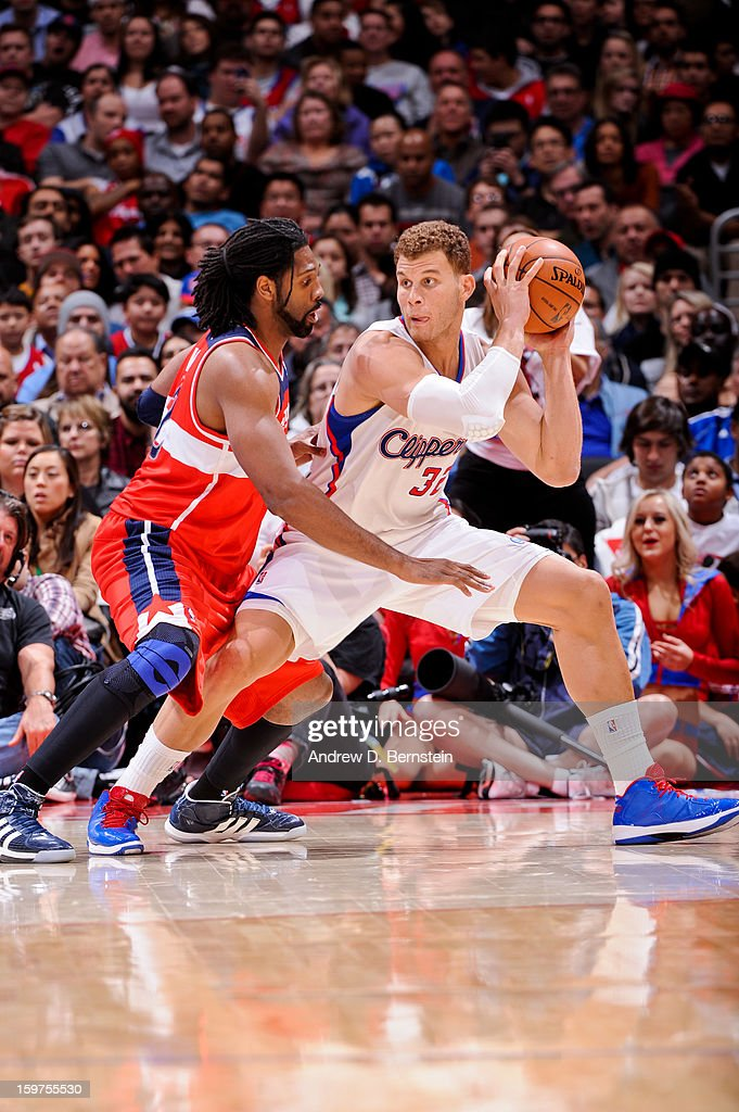 Blake Griffin #32 of the Los Angeles Clippers posts-up against Nene #42 of the Washington Wizards at Staples Center on January 19, 2013 in Los Angeles, California.