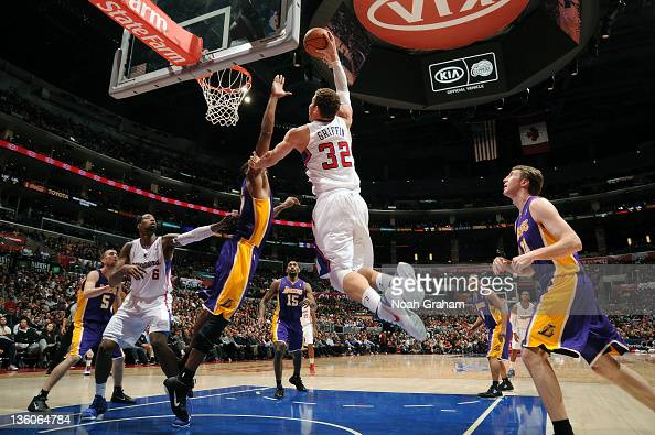 Blake Griffin of the Los Angeles Clippers prepares to dunk over Andrew Bynum of the Los Angeles Lakers at Staples Center on December 21 2011 in Los...