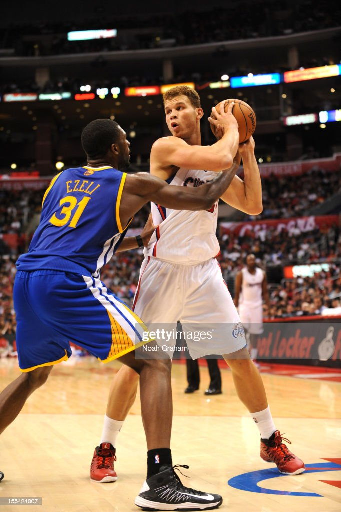Blake Griffin #32 of the Los Angeles Clippers protects the ball from Festus Ezeli #31 of the Golden State Warriors during the game between the Los Angeles Clippers and the Golden State Warriors at Staples Center on November 3, 2012 in Los Angeles, California.