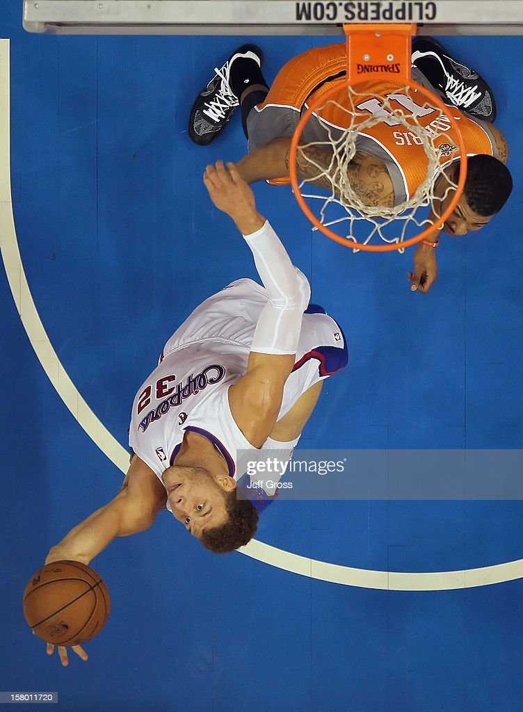 Blake Griffin #32 of the Los Angeles Clippers pulls down a rebound in front of Markieff Morris #11 of the Phoenix Suns in the first half at Staples Center on December 8, 2012 in Los Angeles, California. The Clippers defeated the Suns 117-99.
