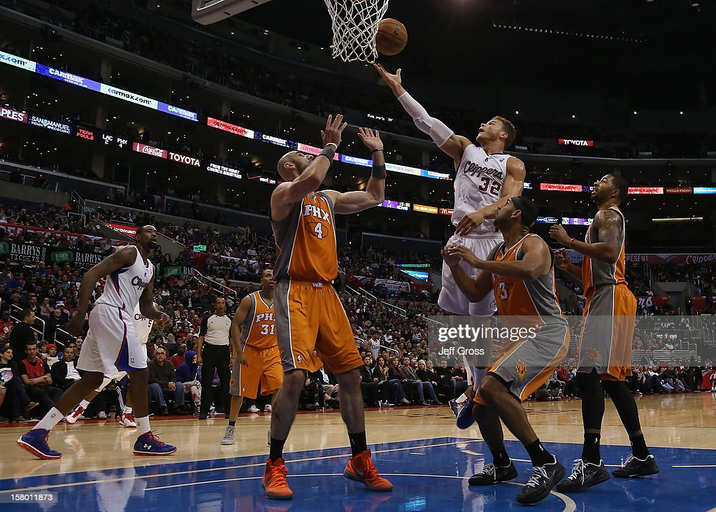 Blake Griffin #32 of the Los Angeles Clippers pulls down a rebound in front of Marcin Gortat (L) #4, Jared Dudley #3 and Markieff Morris #11 of the Phoenix Suns in the second half at Staples Center on December 8, 2012 in Los Angeles, California. The Clippers defeated the Suns 117-99.