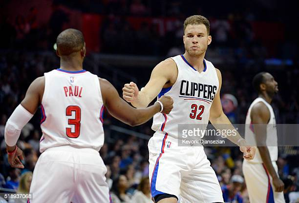 Blake Griffin of the Los Angeles Clippers pumps fists with Chris Paul as he starts the basketball game against The Washington Wizards at Staples...