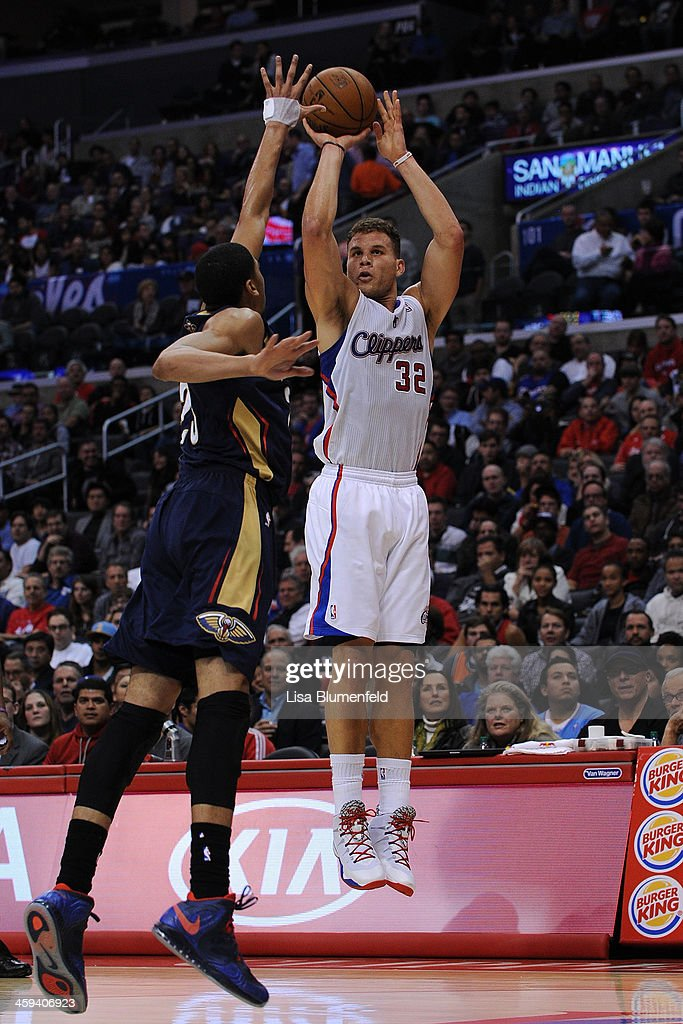 Blake Griffin #32 of the Los Angeles Clippers puts a shot up against Anthony Davis #23 of the New Orleans Pelicans at Staples Center on December 18, 2013 in Los Angeles, California.