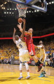 Blake Griffin of the Los Angeles Clippers puts up a shot against Marreese Speights of the Golden State Warriors in Game Six of the Western Conference...