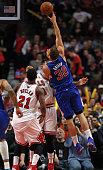 Blake Griffin of the Los Angeles Clippers puts up a shot over Jimmy Butler and Joakim Noah of the Chicago Bulls on his way to a gamehigh 26 points at...