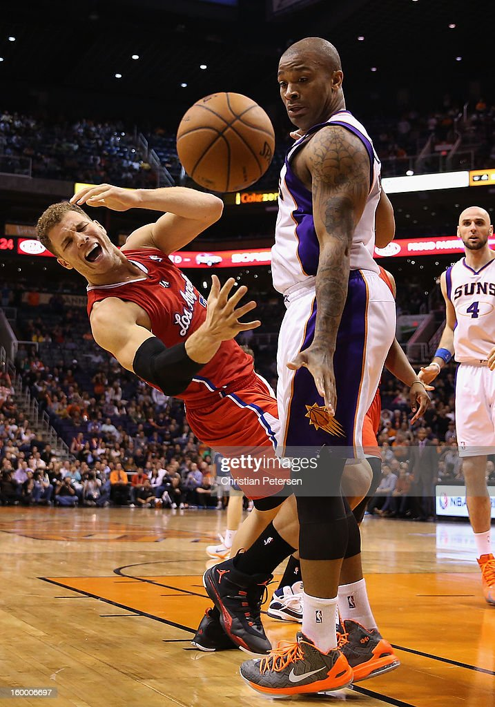 Blake Griffin #32 of the Los Angeles Clippers reacts after a foul from P.J. Tucker #17 of the Phoenix Suns during the NBA game at US Airways Center on January 24, 2013 in Phoenix, Arizona. The Suns defeated the Clippers 93-88.
