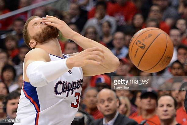 Blake Griffin of the Los Angeles Clippers reacts after getting cut in the second quarter while taking on the San Antonio Spurs in Game Four of the...