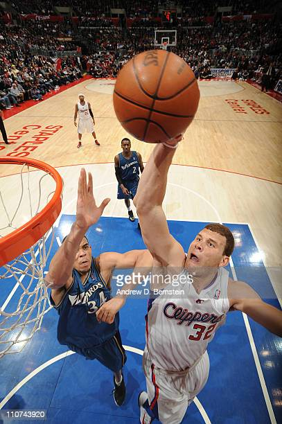 Blake Griffin of the Los Angeles Clippers rises for a dunk against JaVale McGee of the Washington Wizards at Staples Center on March 23 2011 in Los...