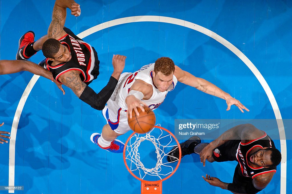 Blake Griffin #32 of the Los Angeles Clippers rises for a dunk against LaMarcus Aldridge #12 and J.J. Hickson #21 of the Portland Trail Blazers at Staples Center on January 27, 2013 in Los Angeles, California.