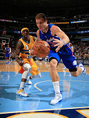 Blake Griffin of the Los Angeles Clippers saves the ball from going out of bounds against Ty Lawson of the Denver Nuggets at Pepsi Center on December...