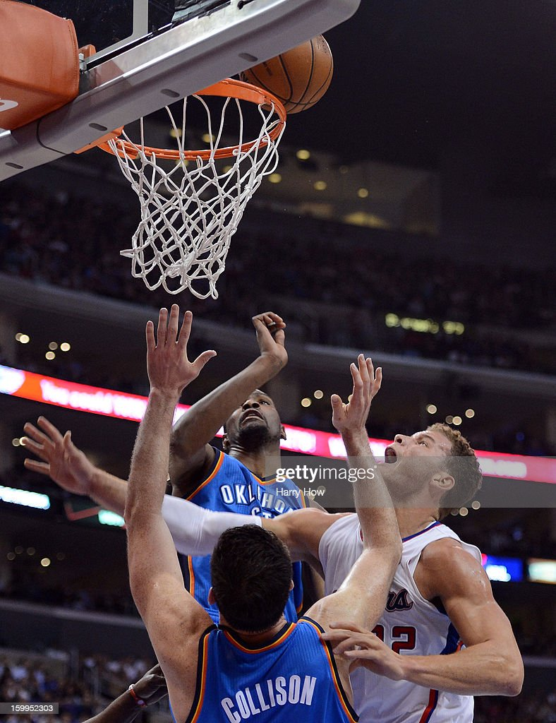 Blake Griffin #32 of the Los Angeles Clippers scores in between Kevin Durant #35 and Nick Collison #4 of the Oklahoma City Thunder during a 109-97 Thunder win at Staples Center on January 22, 2013 in Los Angeles, California.