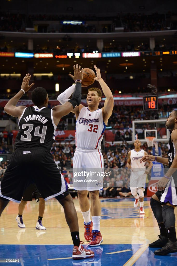 Blake Griffin #32 of the Los Angeles Clippers shoots a pass over Jason Thompson #34 of the Sacramento Kings during the game between the Los Angeles Clippers and the Sacramento Kings at Staples Center on December 1, 2012 in Los Angeles, California.