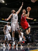 Blake Griffin of the Los Angeles Clippers shoots against Marc Gasol of the Memphis Grizzlies on April 5 2011 at FedExForum in Memphis Tennessee NOTE...