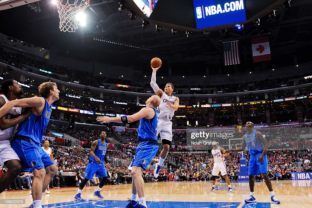 <a gi-track='captionPersonalityLinkClicked' href=/galleries/search?phrase=Blake+Griffin+-+Basketball+Player&family=editorial&specificpeople=4216010 ng-click='$event.stopPropagation()'>Blake Griffin</a> #32 of the Los Angeles Clippers shoots in the lane against <a gi-track='captionPersonalityLinkClicked' href=/galleries/search?phrase=Chris+Kaman&family=editorial&specificpeople=201661 ng-click='$event.stopPropagation()'>Chris Kaman</a> #35 of the Dallas Mavericks at Staples Center on January 9, 2013 in Los Angeles, California.