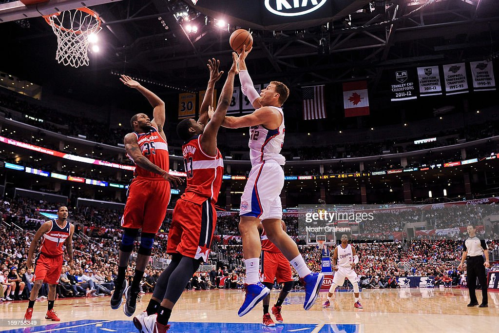 Blake Griffin #32 of the Los Angeles Clippers shoots in the lane against Kevin Seraphin #13 and Trevor Booker #35 of the Washington Wizards at Staples Center on January 19, 2013 in Los Angeles, California.
