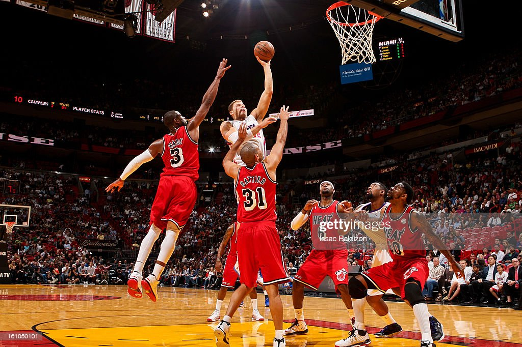 Blake Griffin #32 of the Los Angeles Clippers shoots in the lane against Dwyane Wade #3 and Shane Battier #31 of the Miami Heat on February 8, 2013 at American Airlines Arena in Miami, Florida.