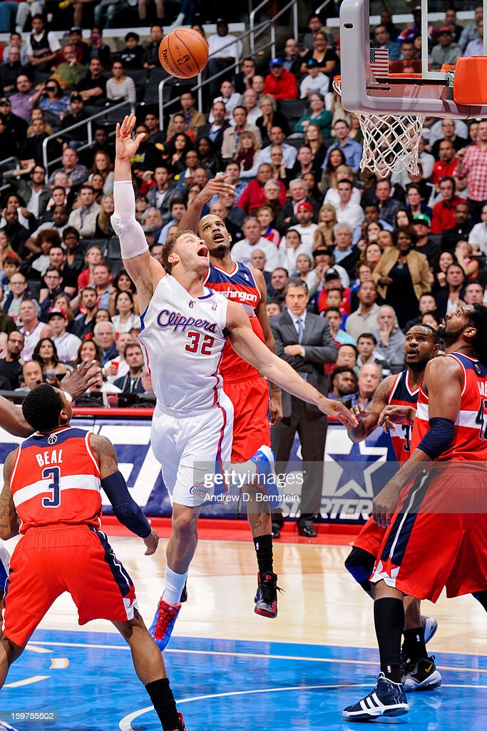 Blake Griffin #32 of the Los Angeles Clippers shoots in the lane ahead of Trevor Ariza #1 of the Washington Wizards at Staples Center on January 19, 2013 in Los Angeles, California.