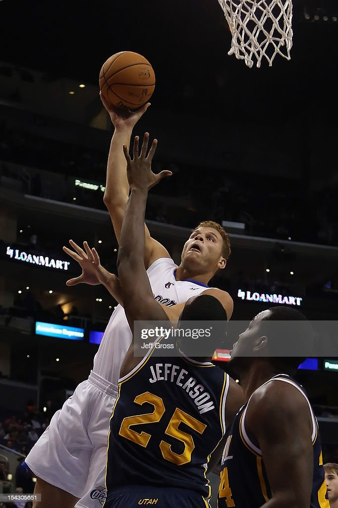 <a gi-track='captionPersonalityLinkClicked' href=/galleries/search?phrase=Blake+Griffin+-+Basketball+Player&family=editorial&specificpeople=4216010 ng-click='$event.stopPropagation()'>Blake Griffin</a> #32 of the Los Angeles Clippers shoots over <a gi-track='captionPersonalityLinkClicked' href=/galleries/search?phrase=Al+Jefferson&family=editorial&specificpeople=201604 ng-click='$event.stopPropagation()'>Al Jefferson</a> #25 of the Utah Jazz during the first half of a preseason game at Staples Center on October 17, 2012 in Los Angeles, California. The Clippers defeated the Jazz 96-94.