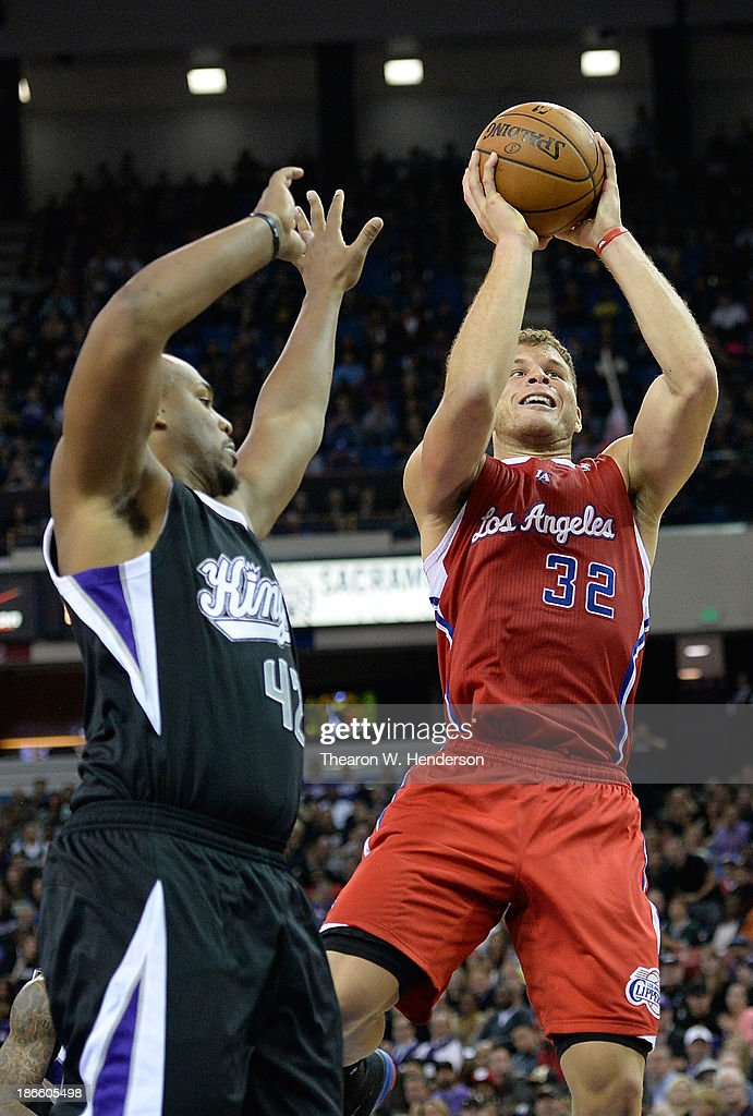 Blake Griffin #32 of the Los Angeles Clippers shoots over Chuck Hayes #42 of the Sacramento Kings during the third quarter at Sleep Train Arena on November 1, 2013 in Sacramento, California.