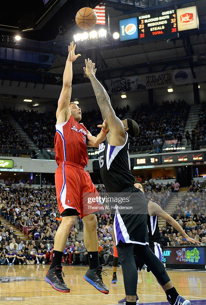 Blake Griffin #32 of the Los Angeles Clippers shoots over DeMarcus Cousins #15 of the Sacramento Kings during the third quarter at Sleep Train Arena on November 1, 2013 in Sacramento, California.