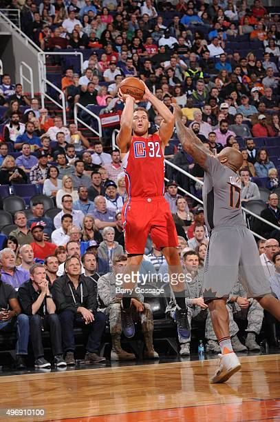 Blake Griffin of the Los Angeles Clippers shoots over PJ Tucker of the Phoenix Suns on November 12 at Talking Stick Resort Arena in Phoenix Arizona...