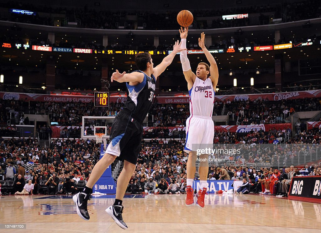 <a gi-track='captionPersonalityLinkClicked' href=/galleries/search?phrase=Blake+Griffin&family=editorial&specificpeople=4216010 ng-click='$event.stopPropagation()'>Blake Griffin</a> #32 of the Los Angeles Clippers shoots the jumper against Darko Millicic #31 of the Minnesota Timberwolves at Staples Center on January 20, 2012 in Los Angeles, California.