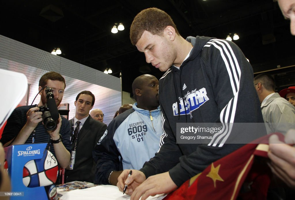 Blake Griffin of the Los Angeles Clippers signs autographs during a appearance at the State Farm Scratch Center at Jam Session presented by Adidas during NBA All Star Weekend on February 20, 2011 in Los Angeles California.