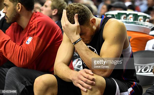 Blake Griffin of the Los Angeles Clippers sits on the bench as time winds down in the fourth quarter of Game Four of the Western Conference...