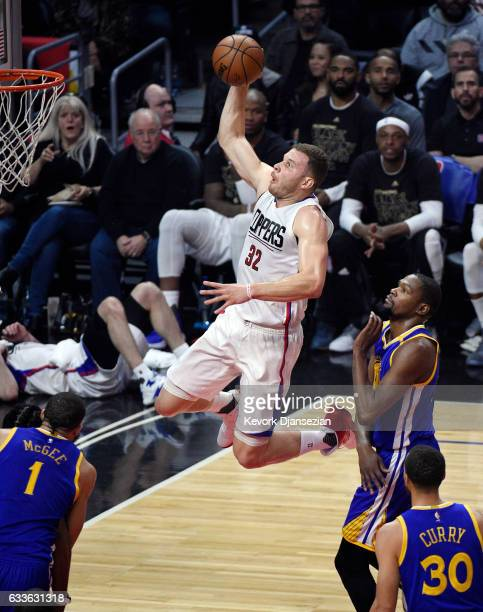 Blake Griffin of the Los Angeles Clippers slam dunks against Kevin Durant of the Golden State Warriors during the first half of the basketball game...