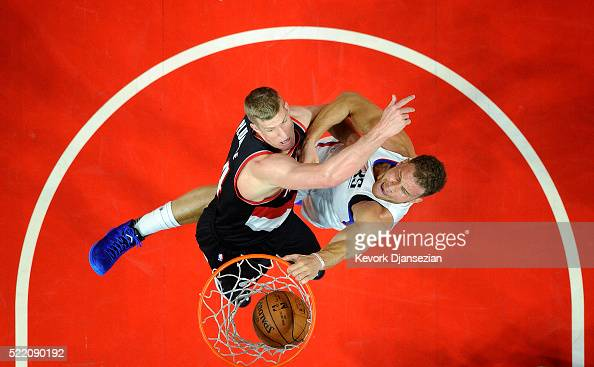 Blake Griffin of the Los Angeles Clippers slam dunks against Mason Plumlee of the Portland Trail Blazers during the first half in Game One of the...