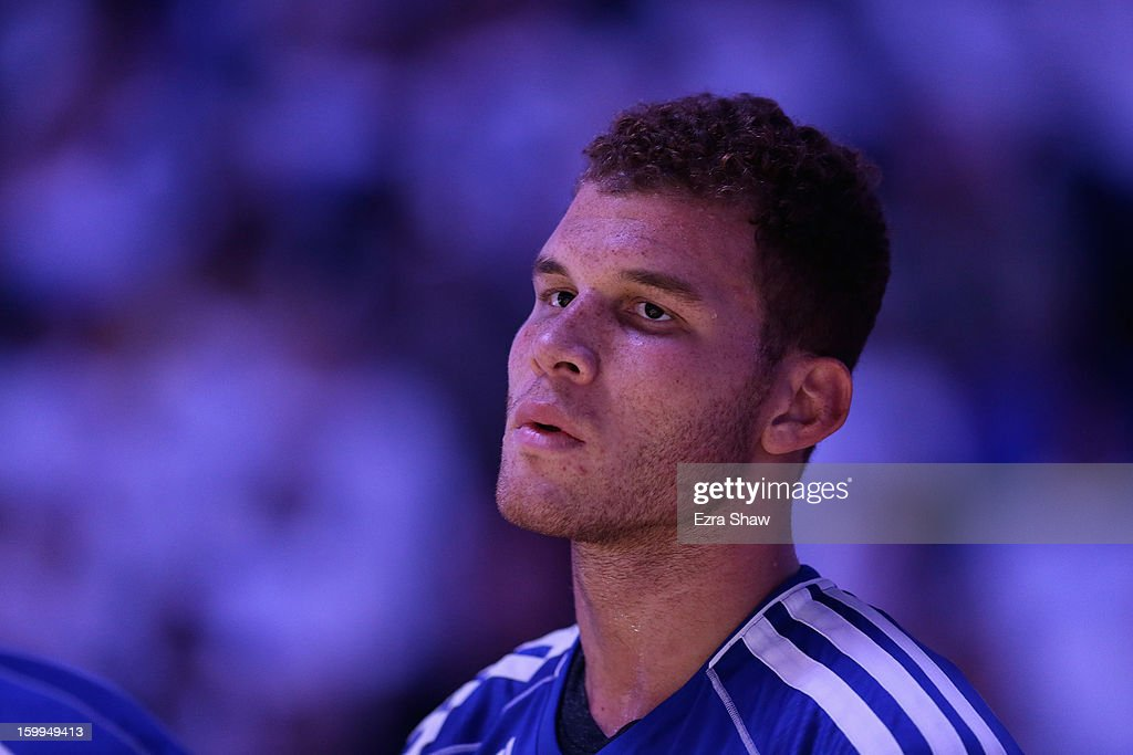 <a gi-track='captionPersonalityLinkClicked' href=/galleries/search?phrase=Blake+Griffin+-+Basketball+Player&family=editorial&specificpeople=4216010 ng-click='$event.stopPropagation()'>Blake Griffin</a> #32 of the Los Angeles Clippers stands for the National Anthem before their game against the Golden State Warriors at Oracle Arena on January 2, 2013 in Oakland, California.