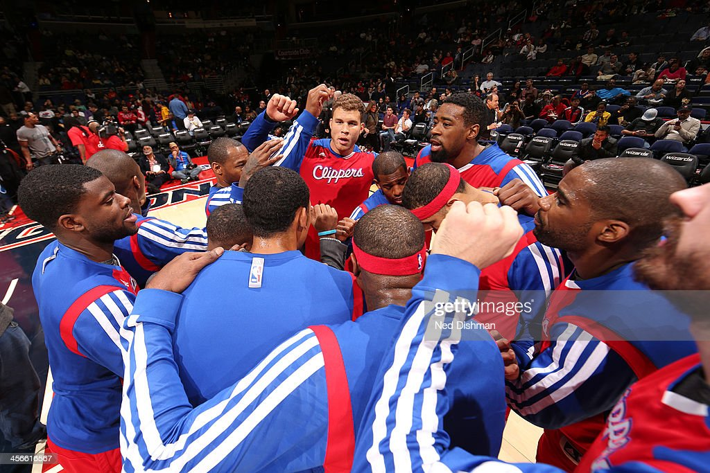 <a gi-track='captionPersonalityLinkClicked' href=/galleries/search?phrase=Blake+Griffin+-+Basketball+Player&family=editorial&specificpeople=4216010 ng-click='$event.stopPropagation()'>Blake Griffin</a> #32 of the Los Angeles Clippers stands in a pre-game huddle against the Washington Wizards during the game at the Verizon Center on December 14, 2013 in Washington, DC.