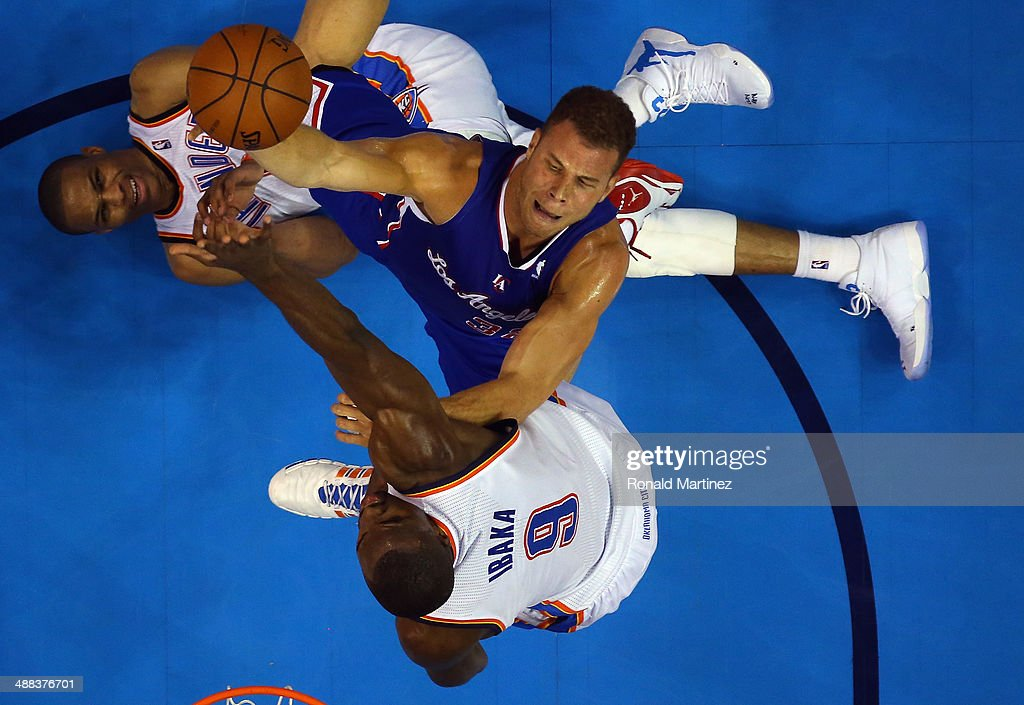 <a gi-track='captionPersonalityLinkClicked' href=/galleries/search?phrase=Blake+Griffin+-+Basketballer&family=editorial&specificpeople=4216010 ng-click='$event.stopPropagation()'>Blake Griffin</a> #32 of the Los Angeles Clippers takes a shot against <a gi-track='captionPersonalityLinkClicked' href=/galleries/search?phrase=Russell+Westbrook&family=editorial&specificpeople=4044231 ng-click='$event.stopPropagation()'>Russell Westbrook</a> #0 and <a gi-track='captionPersonalityLinkClicked' href=/galleries/search?phrase=Serge+Ibaka&family=editorial&specificpeople=5133378 ng-click='$event.stopPropagation()'>Serge Ibaka</a> #9 of the Oklahoma City Thunder in Game One of the Western Conference Semifinals during the 2014 NBA Playoffs at Chesapeake Energy Arena on May 5, 2014 in Oklahoma City, Oklahoma.