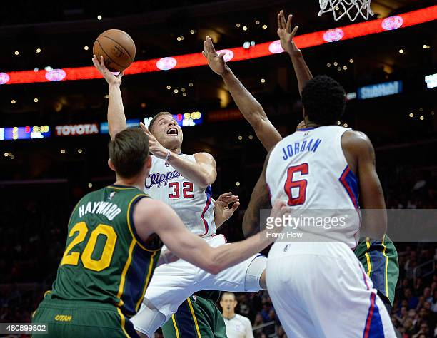 Blake Griffin of the Los Angeles Clippers takes a shot as he is fouled by Derrick Favors of the Utah Jazz during the first half at Staples Center on...
